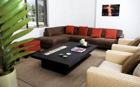 L Shaped Wooden Sofas L Shaped Brown Fabric Sofa With Grey Pattern Cushions Added By
