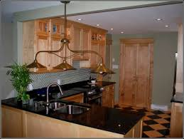 Birch Kitchen Cabinets Yellow Birch Cabinets With Black Granite Counter Tops And What