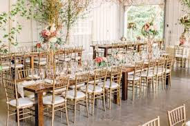 chaivari chairs gold chiavari chairs and wood dining tables