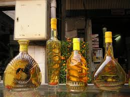 alcoholic drinks bottles 4 liquor bottles on glass top table free image peakpx