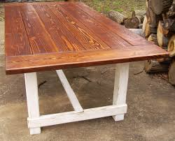 custom reclaimed wood trestle style farmhouse table with antiqued