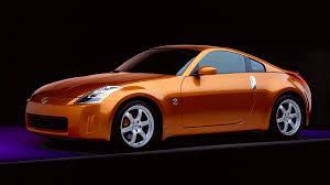 Nissan 350z Orange - orange nissan 350z on a black background wallpapers and images