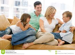 Family Sitting In Living Room Smiling Royalty Free Stock Image - Family in living room