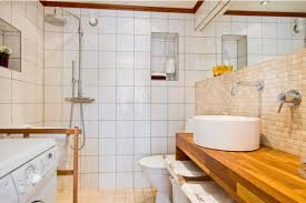 smart small bathroom with white wall tiles wooden vanity with