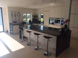 cosmis black granite in a polished finish kitchen island with
