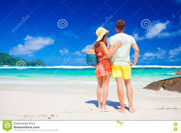 Tropical Clothes For Travel Couple Wearing Bright Clothes On A Tropical Beach On Mahe Island