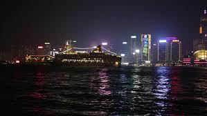 hong kong light show cruise hong kong light show at night time cruise liner ship on foreground