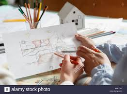 interior designers working on color hand drawings of a kitchen