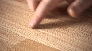 how to repair scratches in a manufactured hardwood floor
