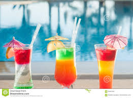 cocktail drinks on the beach colored cocktails on a background of water colorful cocktails