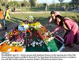 Flower Garden App by Visitors Poses With Displayed Flowers On The Opening Day Of The