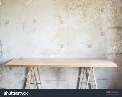 concrete wall wooden workshop table against concrete wall stock photo 440352355