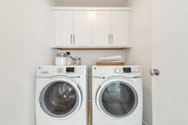 laundry room cabinets over washer and dryer stacked navy blue