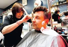 haircuts shop calgary nicole bellamy owner of the classic barber shop uses a straight