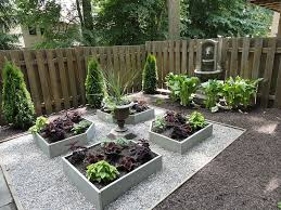 maximize a small outdoor area by adding raised beds and a gurgling