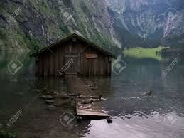 small farmhouse on the lake konigsee stock photo picture and