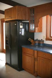 above refrigerator cabinet hanging microwaves other kitchen