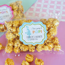 popcorn favors she s going to pop caramel popcorn decorations baby shower