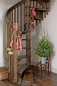wooden spiral staircase with christmas decorations decorating
