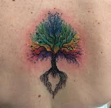 watercolor tree tattoo on upper back