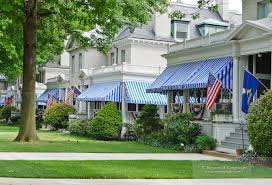 Striped Awning White Brick Homes With American Flags And Blue And White Striped