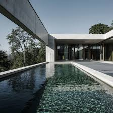 concrete block houses taller hector barroso u0027s white concrete house surrounds tranquil pool