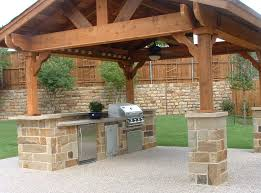 backyard kitchen ideas outdoor rustic outdoor kitchen ideas with solid wood patio cover