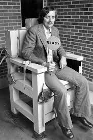electric chair spirit halloween news reporter bob lowry sitting in the alabama electric chair