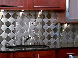 stainless steel backsplash with granite countertops kitchen