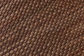 stuoia bamboo fondo fatto a mano della stuoia marrone tessuto bambù fotografia
