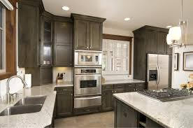 ample dark kitchen cabinets with light island mixed white window