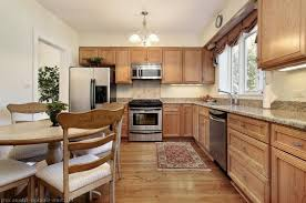 white kitchen cabinets with black island white kitchen cabinet classic wood table brown marble tile of