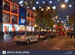 Christmas Decorations Oxford Street - london taxis and buses queuing in oxford street below christmas