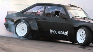 hoonigan nissan ken block fries tires in his first gymkhana ford escort at the