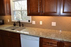 subway tile in kitchen backsplash chage glass subway tile herringbone kitchen backsplash idolza