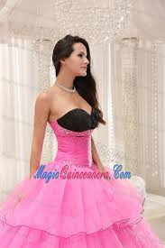rose pink and black sweetheart quinceanera dress with ruffles and