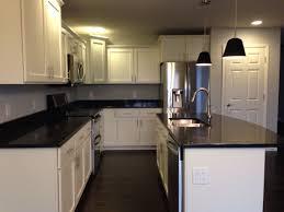 white kitchen cabinets with black quartz kitchen with white shaker cabinets black quartz countertops