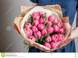 flowers for s day florist girl with peony flowers or pink tulips woman flower