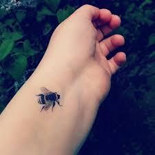 22 bee tattoos on wrist