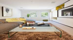 How To Arrange Living Room by How To Arrange A Long Living Room Brown Black Pattern Floor Rug
