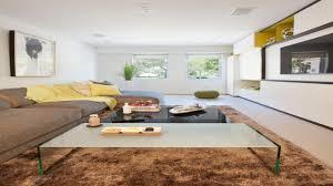 How To Arrange Living Room by How To Arrange A Long Living Room Brown Black Pattern Floor Rug