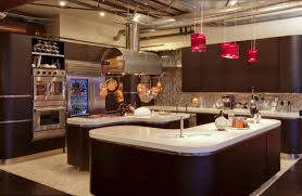 Range In Island Kitchen Cooktop And Stainless Steel Range Hood With Lights Over Island And In