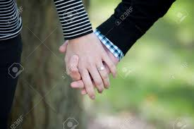 engagement rings hands images Young hands holding with an engagement ring on a sunny day stock jpg
