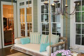 splashy wooden porch swings in porch farmhouse with wooden porch