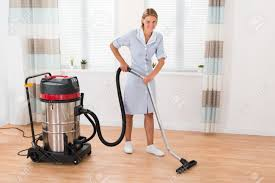 beautiful cleaning wooden floor with vacuum cleaner