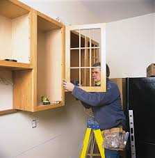 how to secure kitchen base cabinets to wall how to hang kitchen cabinets this house