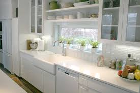 shade of white subway tile backsplash with white cabinets homes