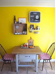 small dining area with yellow wall paiint wooden dining tale and