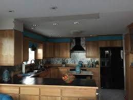 recessed lighting over fireplace captivating kitchen peninsula lighting ideas in fireplace property