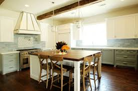 green lower white kitchen cabinets island with butcher block top transitional kitchen